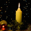 Burning candle with Christmas-tree decor - Stok fotoğraf