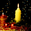 Christmas card with burning candles — Stock Photo