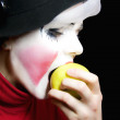 Mime biting apple — Stok Fotoğraf #1586660
