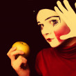 Stock Photo: Sad mime with apple