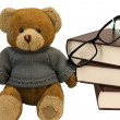Teddy bear, glasses and old books — Stock Photo
