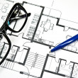 Apartment  Plan with  pencil and glasses - Stok fotoğraf