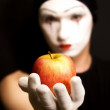 Mime with red apple — Stock Photo