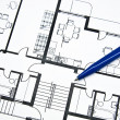 Plan of apartment with a pencil - Stok fotoğraf