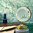 Glass globe and the old boo — Stock Photo