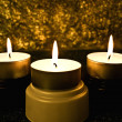 Royalty-Free Stock Photo: Three candles against a dark background