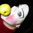 Mime biting apple — Stok Fotoğraf #1588570