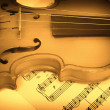 Old violin and musical notes — Stock Photo #1588654
