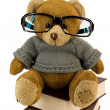 Teddy bear, glasses and pile of old book — Stock Photo