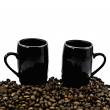 Cups and coffee grains — Stock Photo