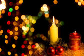 Candle with Christmas-tree decoration — Stock Photo