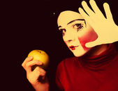 Sad mime with an apple — Stock Photo