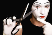 Mime with scissors on black background — Stock Photo