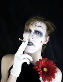 Smoker mime on black background — Stock Photo