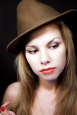 Young fair-haired woman in hat — Stock Photo