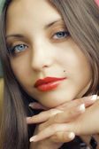 Face of young beautiful brunette woman — Stock Photo