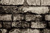 Old grey brick wal — Stock Photo