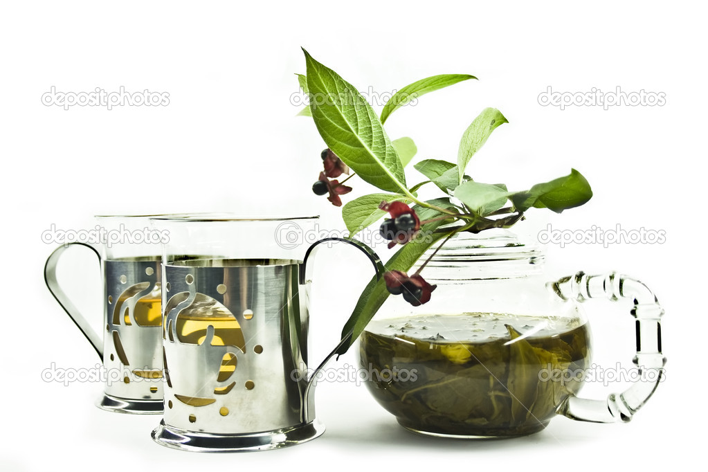 Tea pot and cups with a branch on a white background — Stock Photo #1589100