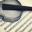 Old violin and musical notes — Stock Photo #1590496