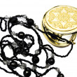 Stock Photo: Pocket mirror and beads