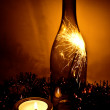 Bottle with Bengalese candles — Stock Photo