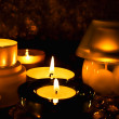 Foto Stock: Group of candles against dark backgrou