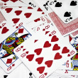 Scattered pack of playing cards - Stock Photo