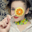 Young woman with a sugar candy — Stock Photo