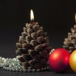 Two candles as a candle with christmas-t — Stock Photo
