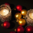 Two candles with christmas-tree decorati — 图库照片