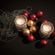 Candles with christmas-tree decorations — Stockfoto
