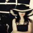 Woman on black background in summer hat — Stock Photo