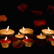Burning candles with petals roses - Stock Photo