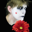 Gloomy mime with red flower — Stock Photo #1603965