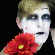 Gloomy mime with  red flower — Stock Photo