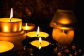 Group of candles against a dark backgrou — Stock Photo
