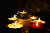 Candles against a dark background — Stock Photo