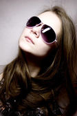 Portrait of young woman in sunglasses — Stock Photo