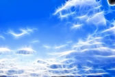 Dark blue sky with clouds — Stock Photo