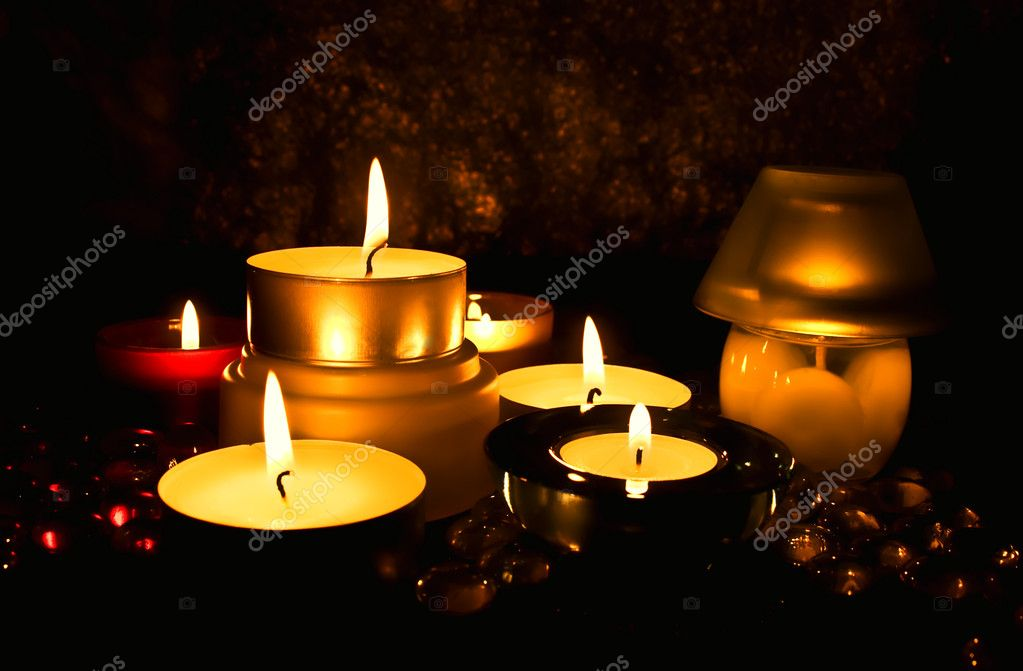 Group of candles against a dark background — Stock Photo #1600400