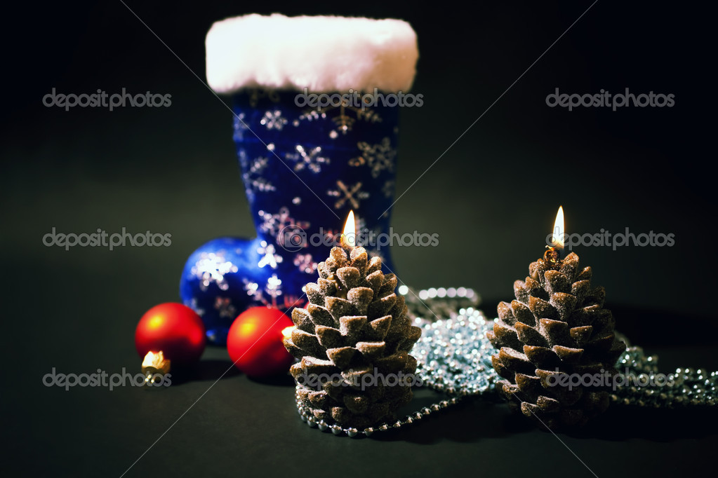 Christmas-tree decorations and christmas candles with dark blue  boot on  black background — Photo #1602301