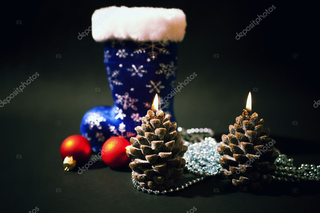 Christmas-tree decorations and christmas candles with dark blue  boot on  black background — Foto Stock #1602301