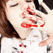 Stock Photo: Young womwith bloodstained face