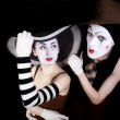 Portrait of two mimes in white gloves - Stock Photo