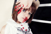 Young woman with bloody face — Stock Photo