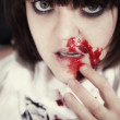 Young woman with  bloodstained face — Stock Photo