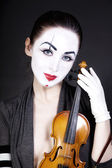 Woman mime with old violin — Stock Photo