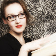 Young woman in glasses with  book — Stock Photo