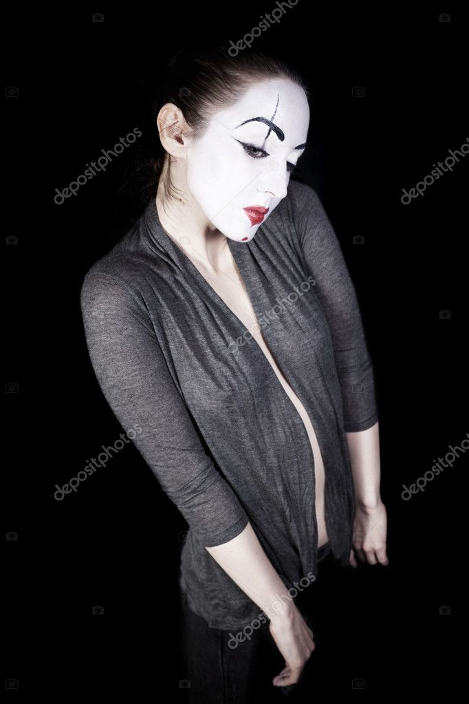 Sad woman  mime in  grey jacket on  black background — Stock Photo #1950910
