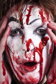 Mime with stained blood feca — Stock Photo